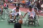 Young men with disabilities use specially designed wheelchairs to play basketball in Timor-Leste.