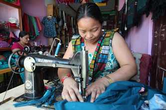 Nama Maya Gurung used finance and training from the Micro-enterprise Development Program to create a business employing and training women in needlework skills, Nepal Photo by Jim Holmes for DFAT