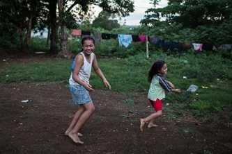 Two Tongan girls keep healthy training to play in a netball competition. Photo by Connor Ashleigh for DFAT.
