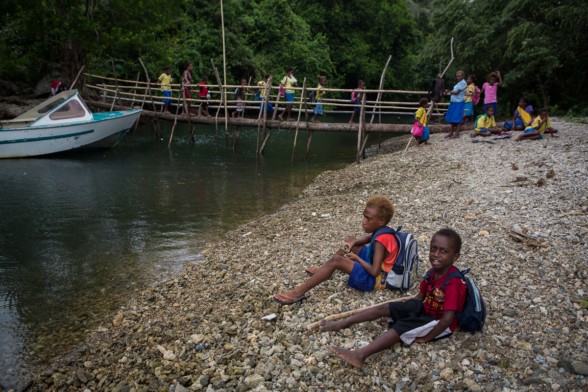 Children wait to board a small boat back to Walla Island after attending school on Malakula Island. Photo by Connor Ashleigh for DFAT.