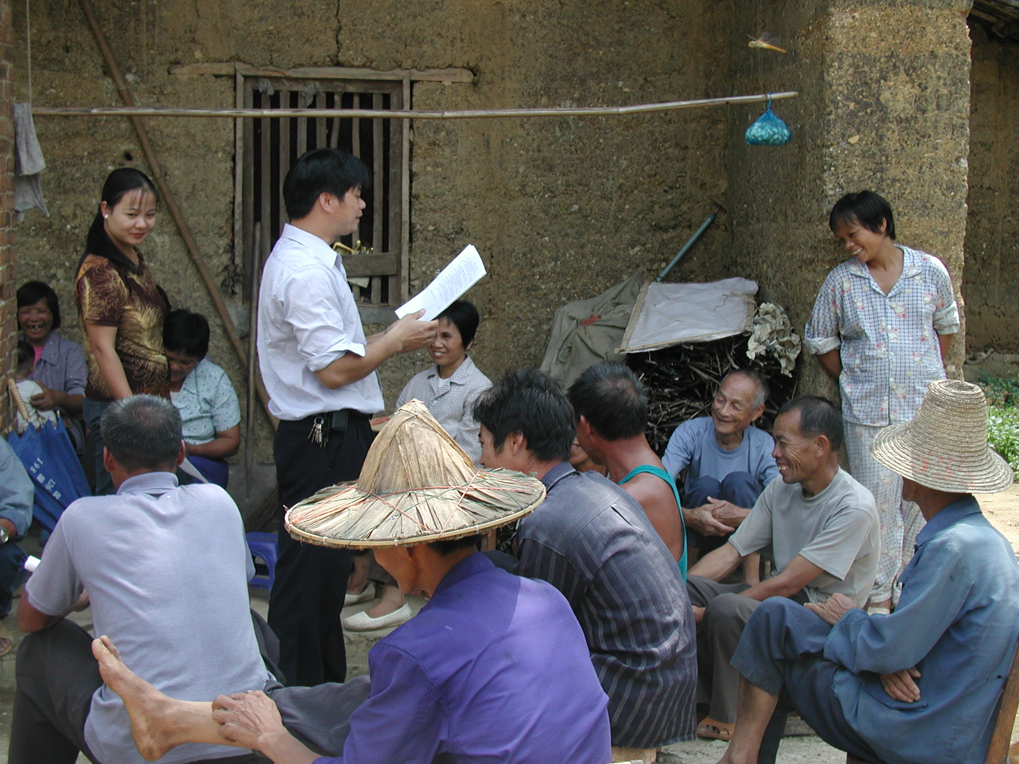 Official discusses farming techniques in a local community, Guizhongliaowang, China. DFAT