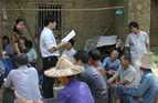 Official discusses farming techniques in a local community, Guizhongliaowang, China.