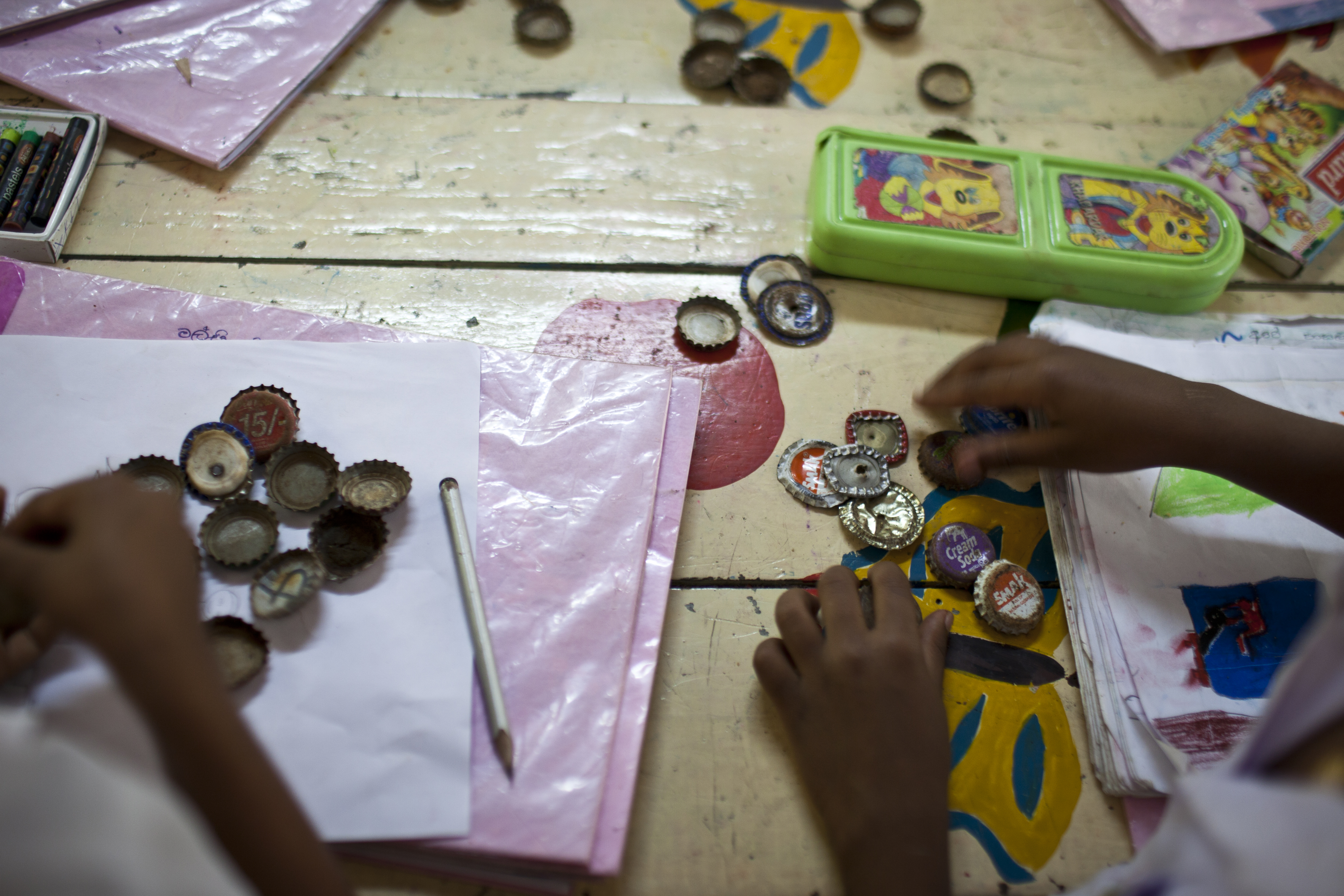 Students from Kiriwaneliya Singla School in Sri Lanka use recycled material for counting. Image by DFAT