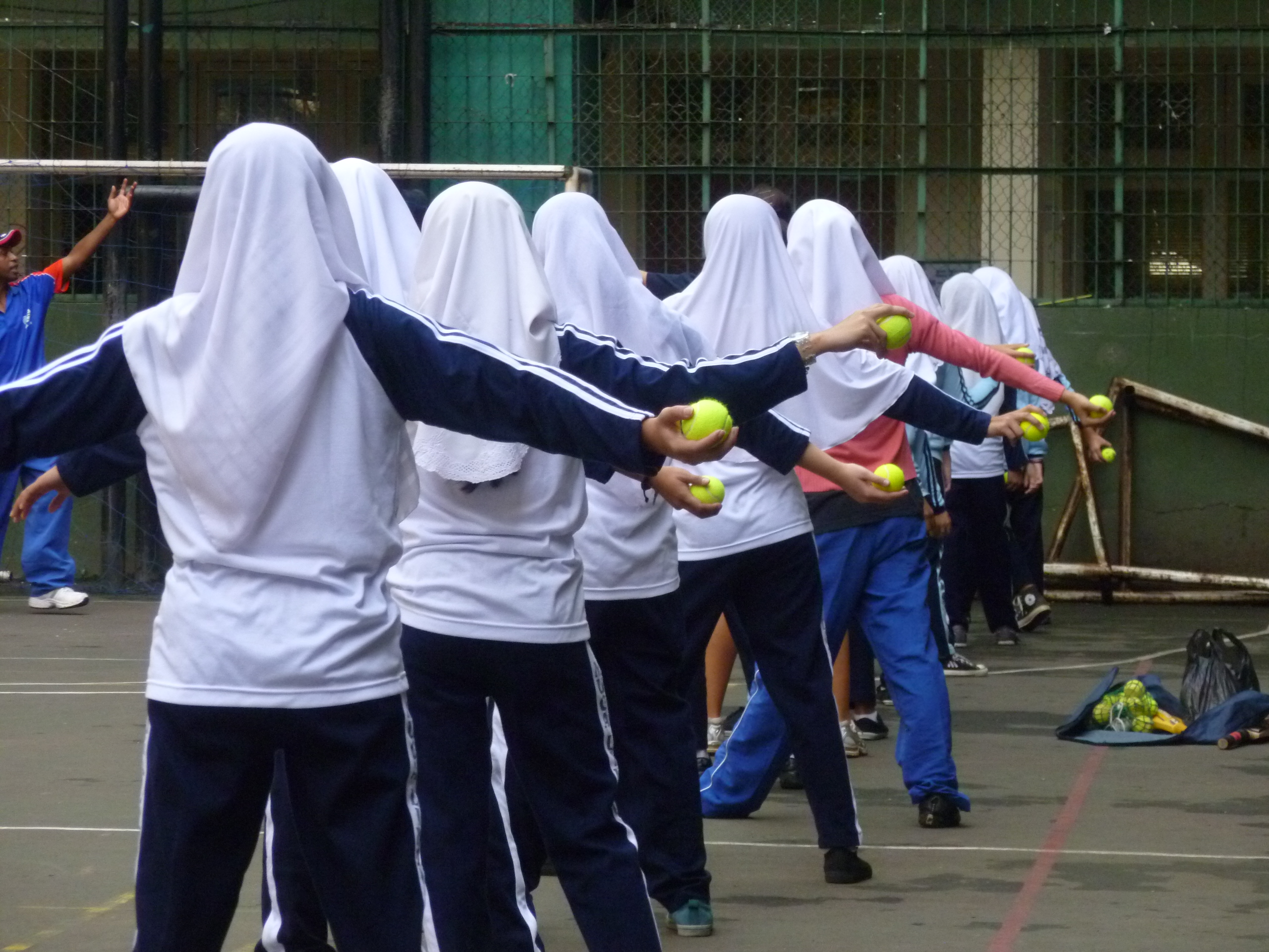 Indonesian school girls learning to play cricket. DFAT