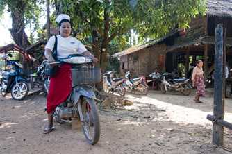 A midwife on the motorbike she uses to attend patients in remote communities in southern Myanmar. Photo by James Howlett, 3DFund.org.