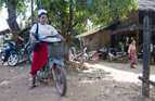 A midwife on the motorbike she uses to attend patients in remote communities in southern Myanmar.