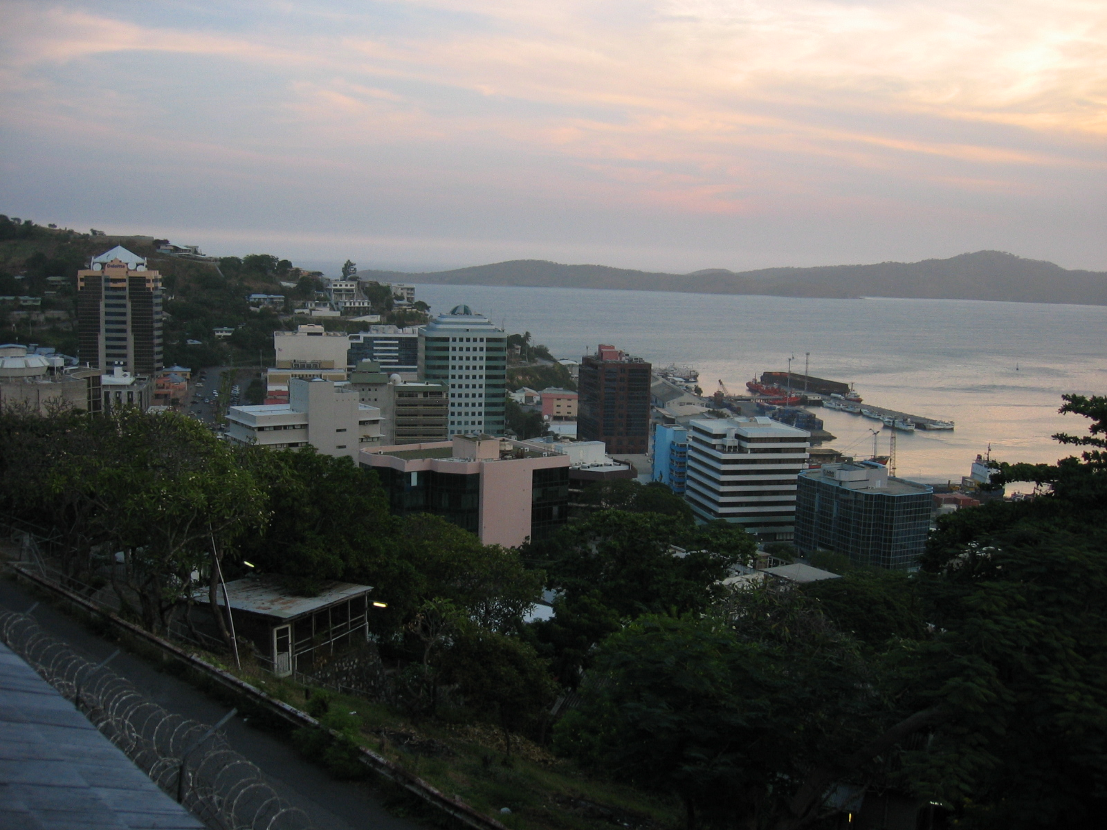 Apartment buildings in  Port Moresby, Papua New Guinea have views over the water but are too expensive for most citizens. This image is from Wikimedia, and is in the public domain.