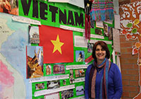 Teacher Judy Wilson and a Vietnam display developed by her class. Used with permission
