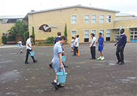 Students carried 10 litres of water to appreciate the hardships endured by the community in Tanzania. St Monica's College, Epping
