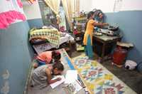 Ganga Pun and her two daughters live in a single room in Pokhara, Nepal.