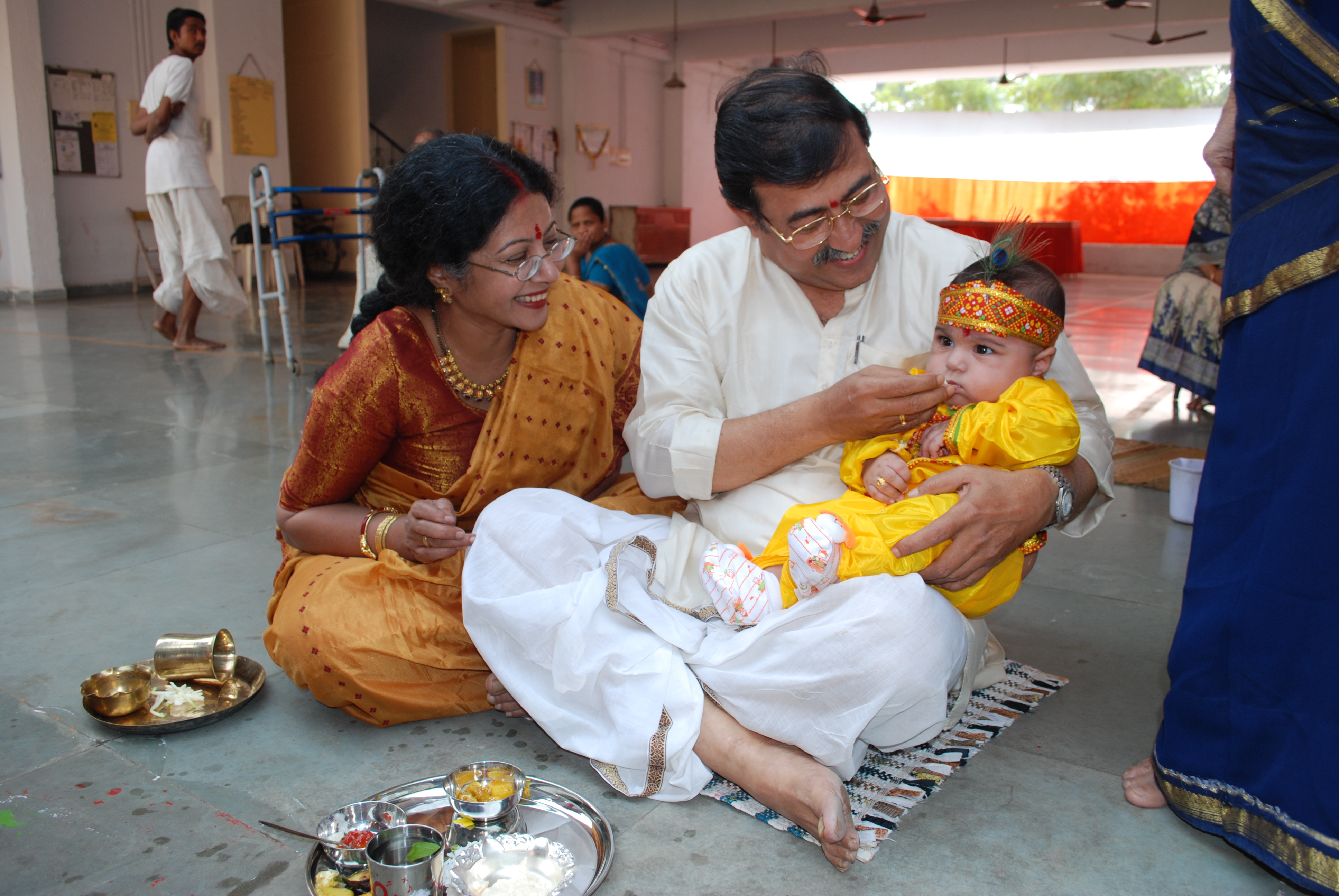 Annaprashan or First Rice, is a Hindu ceremony marking a baby's first meal in which family members feed the baby rice. Photo by Nauzer. This image is from Wikimedia, and is in the public domain.