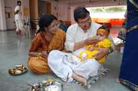 Annaprashan or First Rice, is a Hindu ceremony marking a baby's first meal in which family members feed the baby rice.