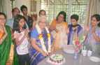 A family gets together to celebrate their grandmother's 80th birthday in Pune, India.