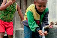 In a crowded urban area of Jakarta, Indonesia, young boys use tank water to stay healthy and clean.