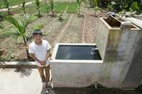 Dao Van Manh in Vietnam has installed a sand filter to clean his stored water.