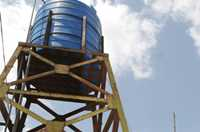 In a health clinic in Vietnam, water is pumped into a storage tank and distributed by pipes using the water pressure.