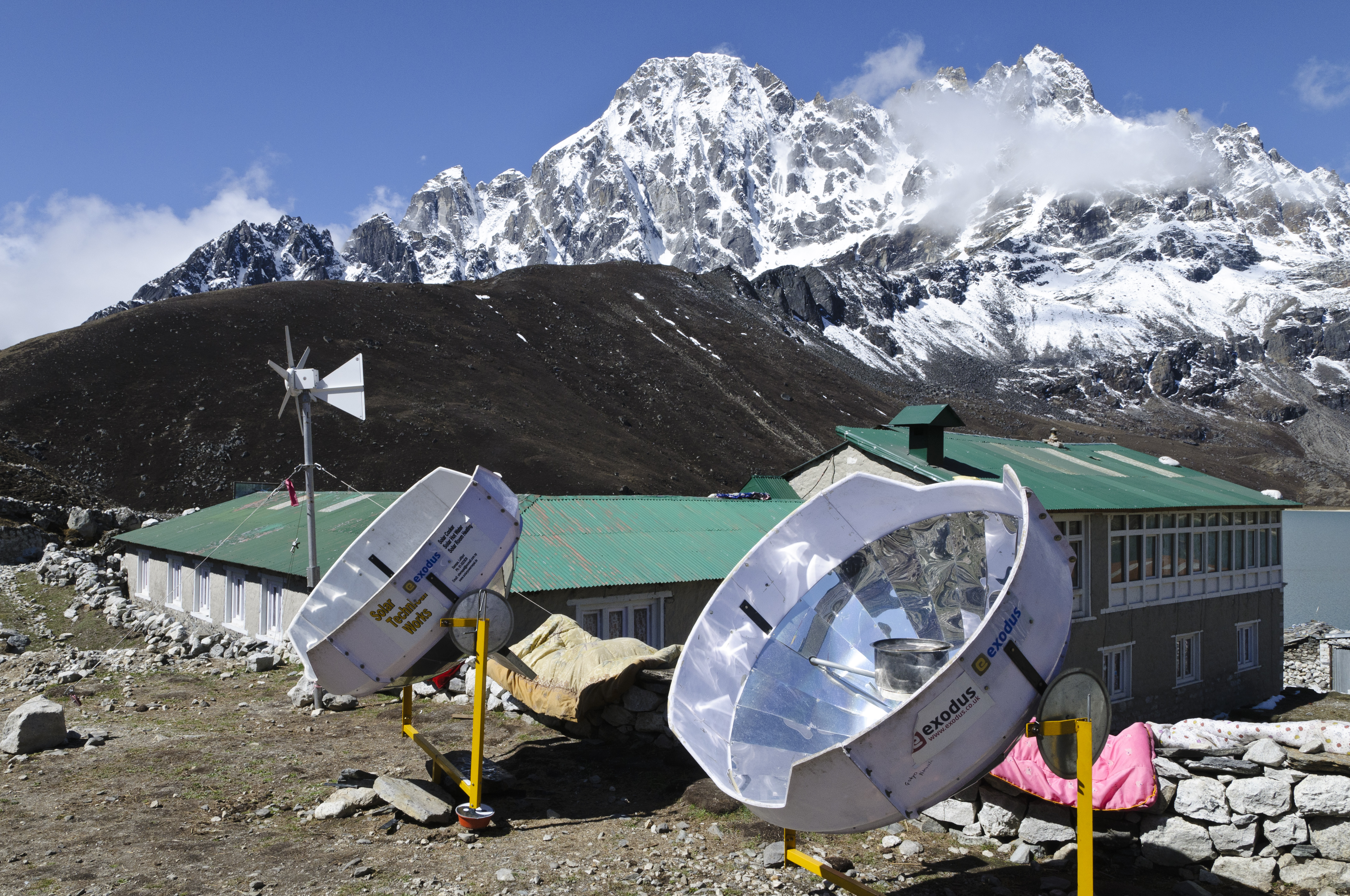 A solar cooker uses the energy of the sun to cook, reducing deforestation in remote areas of Nepal. Grant Dixon / Lonely Planet Images